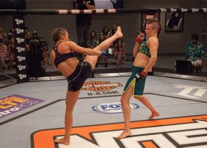 Rose Namajunas (left) kicking at Joanne Calderwood. Pic courtesy of UFC/Zuffa LLC.